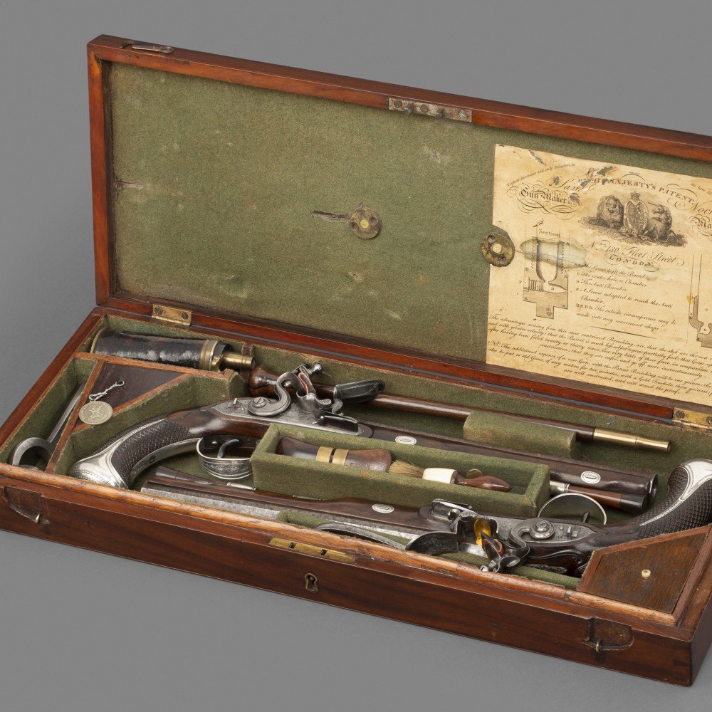An Exceptional Cased Pair of Silver-mounted Flintlock Duelling Pistols by John Twigg, London,