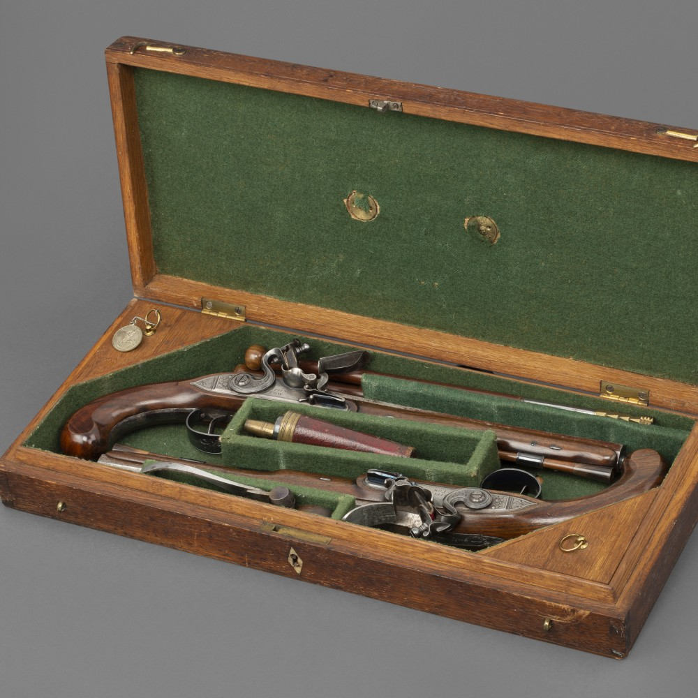 A Cased Pair of Flintlock Duelling Pistols by Griffin & Tow,