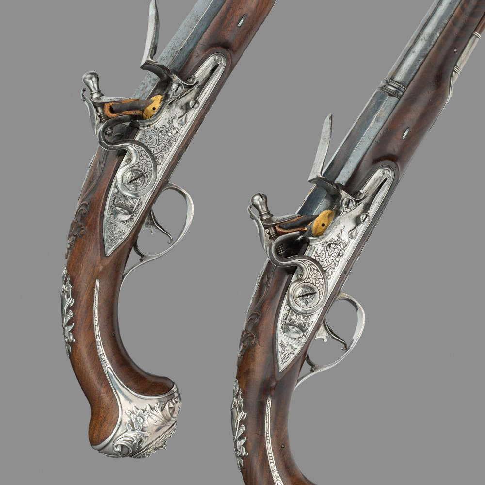 A Pair of Silver Mounted Flintlock Holster Pistols by Henry Hadley, London,