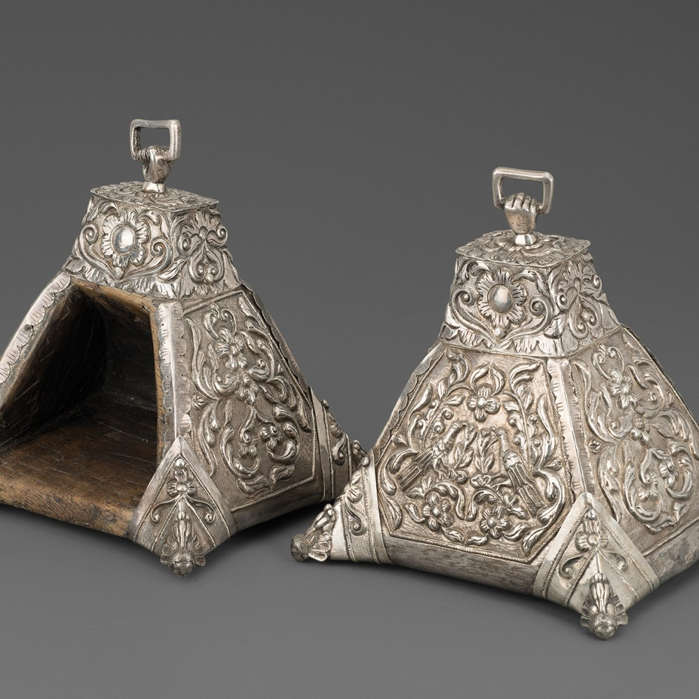 A Pair of Peruvian Boxed Pyramidal Parade Stirrups Encased in Silver,